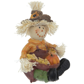 Sitting Scarecrow With Harvest Bundle