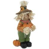 Scarecrow Holding Pumpkin