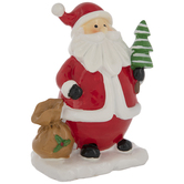 Santa Claus With Bag And Tree