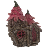 Stone House With Pink Flower Roof