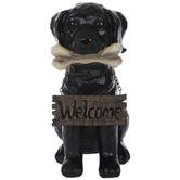 Black Dog Holding Welcome Sign