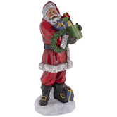 Santa Claus With Gifts And Wreath